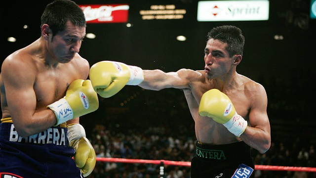 Erik Morales throws a right hand at Marco Antonio Barrera in their rubber match that took place in November 2004. The fight won fight of the year honors in 2004. Photo: Al Bello/Getty Images