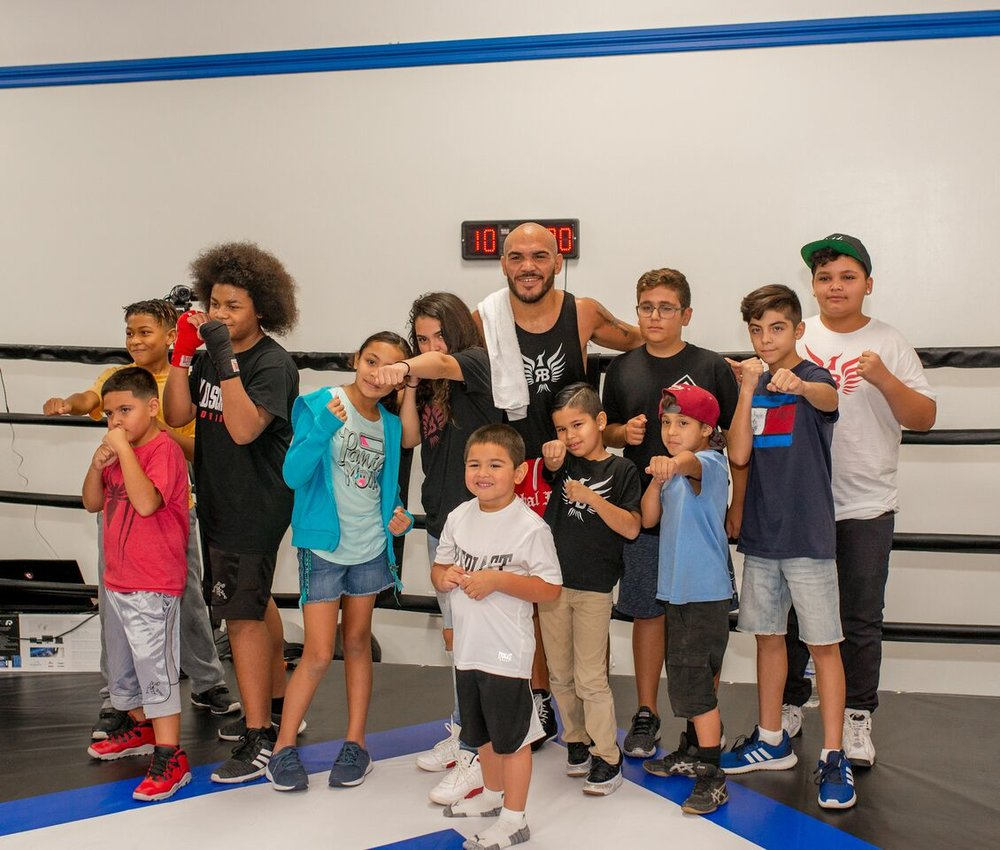 Ray Beltran with a group of fans. Photo: Chas Wright/Top Rank
