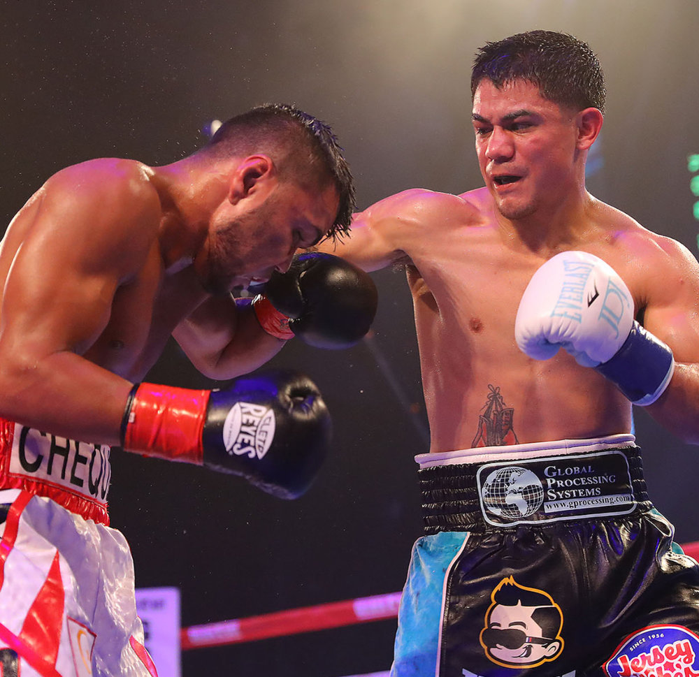 Joseph Diaz lands a right hand on Jesus Rojas. Photo: Golden Boy Promotions