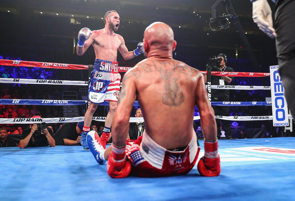 Jose Pedraza celebrates after scoring a knockdown in the eleventh round. Photo: Mikey Williams/Top Rank