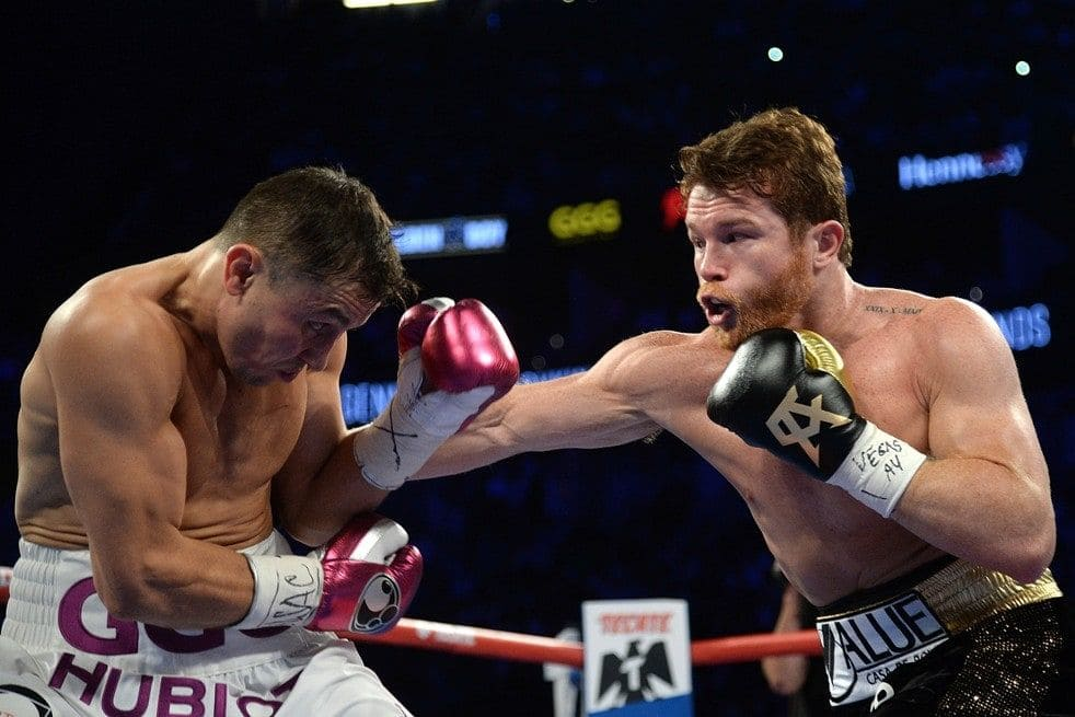 Canelo Alvarez attempts a body shot against Gennady Golovkin. Photo: Joe Camporeale/USA Today Sports