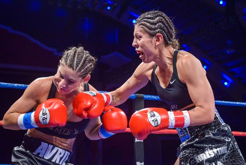 Samantha Salazar lands a right hand on Avril Mathie. Photo: Joseph Correa/Frontproof Media