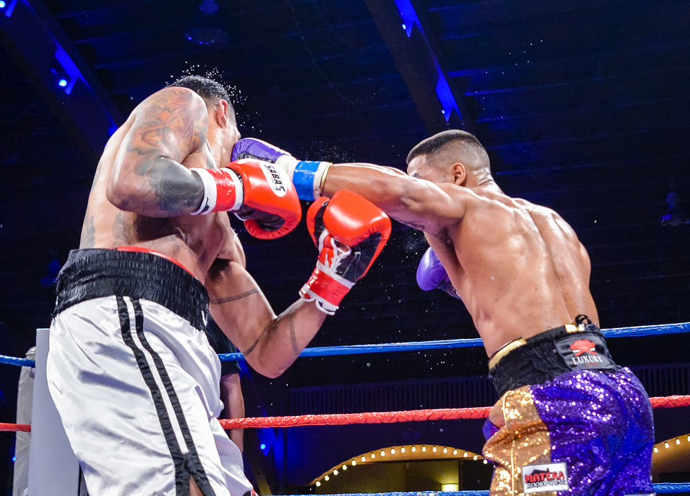Mark Reyes lands a left hook on Juan Jesus Rivera. Photo: Joseph Correa/Frontproof Media