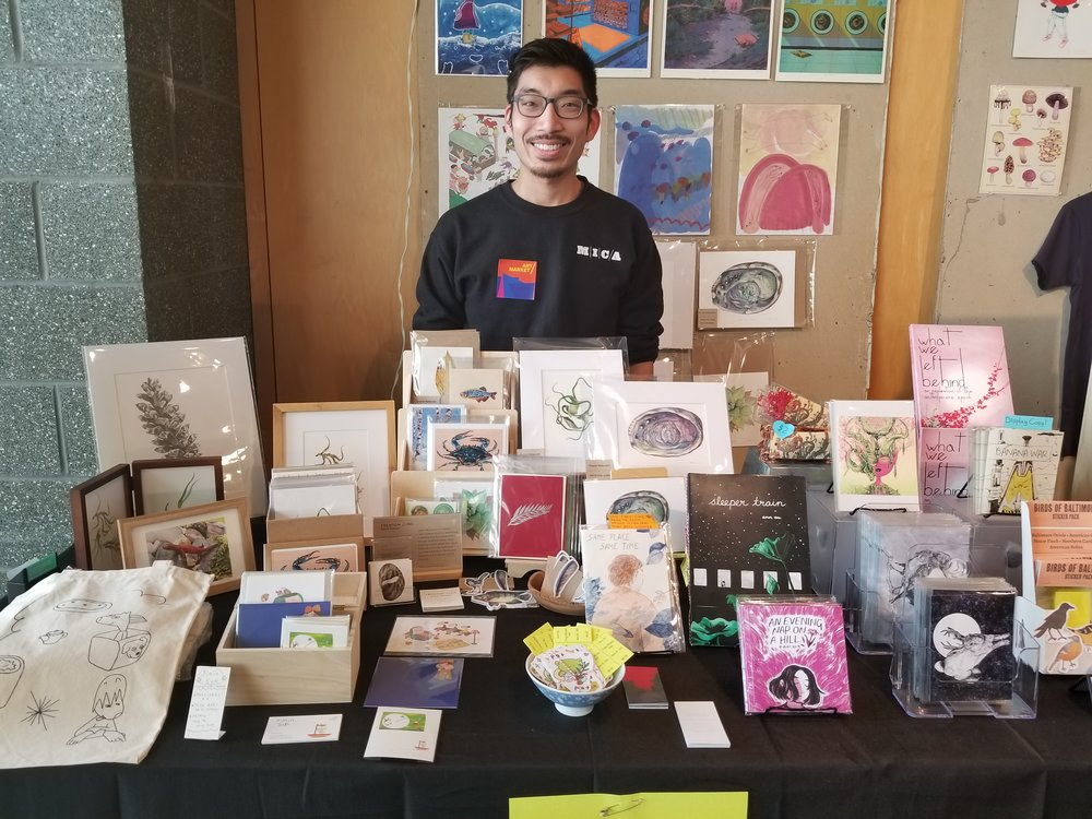 At my Art Market table, my work is on the back half of the table.