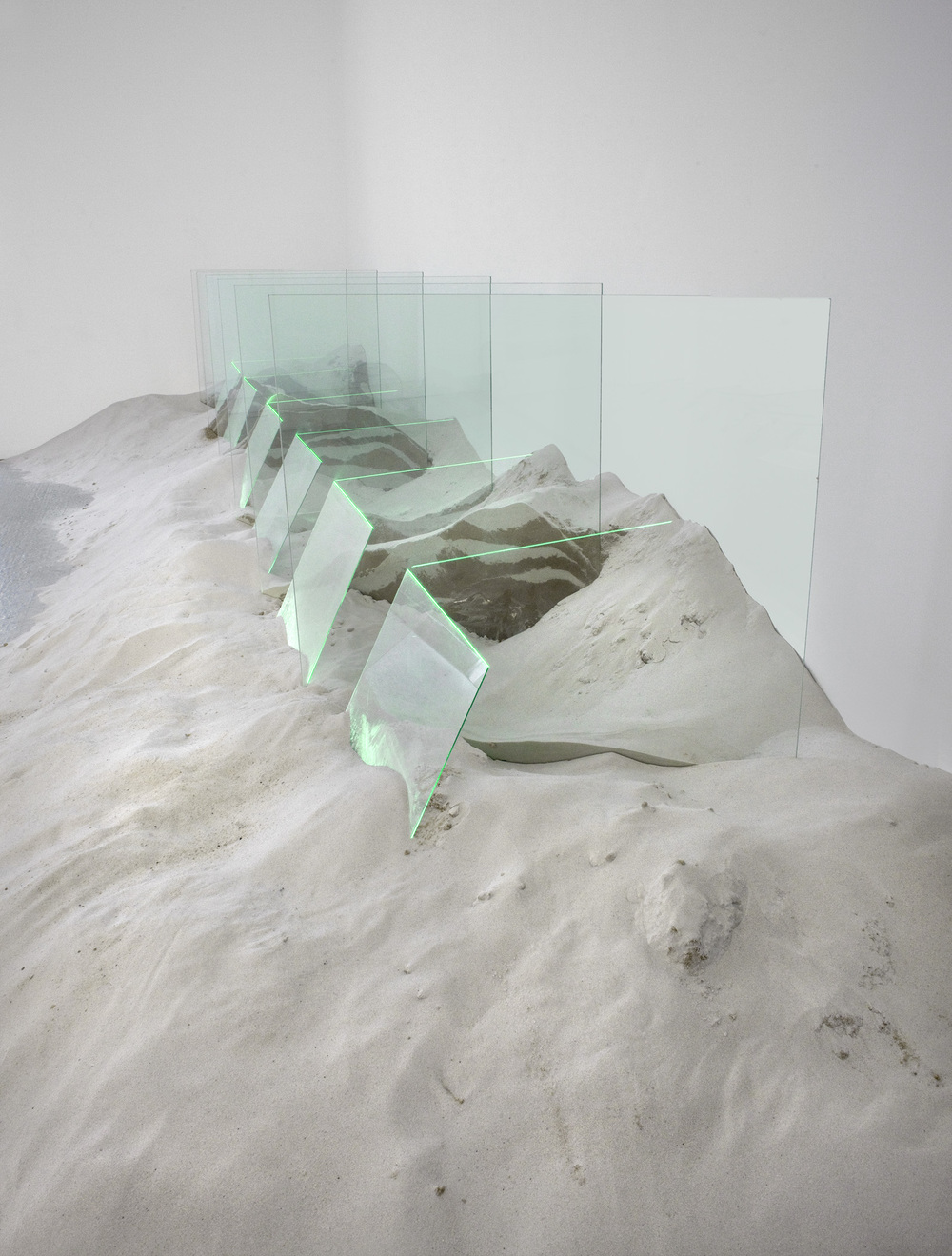 "Untitled    1971   60"" x 80"" x 192""   Glass, sand, argon    Installation at Zwirner Gallery, New York City"