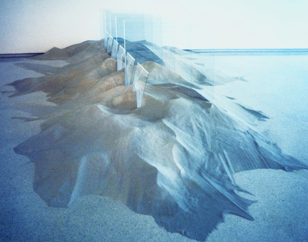 """Untitled   1971  60"""" x 420"""" x 96""""  Sand, glass, argon with mercury  Walker Arts Center, Installation for """"New Workfor New Spaces""""  Collection of Museum of Modern Art, New York"""
