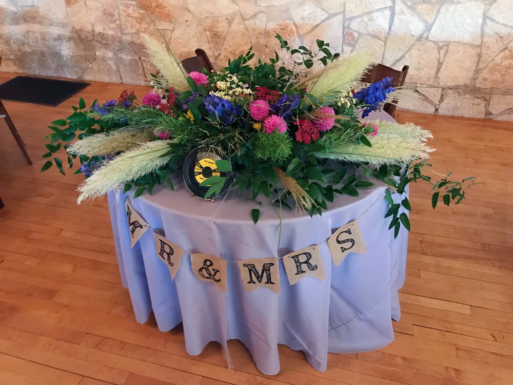 Here is the cross arrangement now placed horizontally on the couple's sweetheart table for the reception.