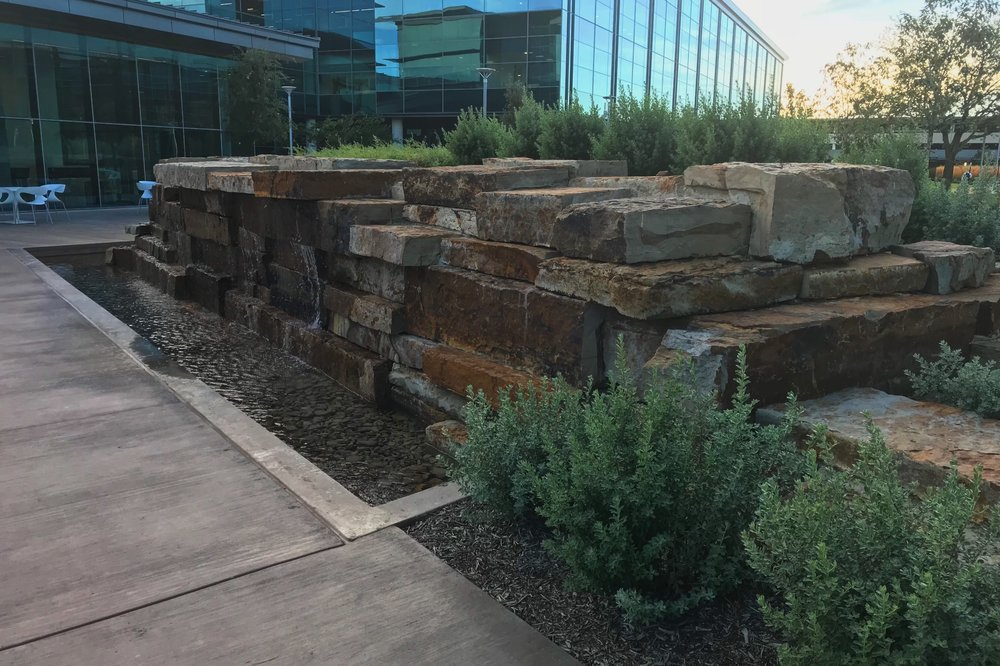 Water feature with local stone.