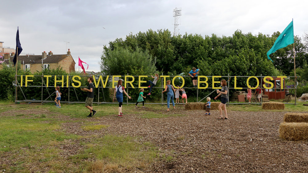 Jessie Brennan,  If This Were to Be Lost  (2016), painted birch plywood on scaffold, 1.9 x 19 m, situated at The Green Backyard, Peterborough. Photograph by Jessie Brennan