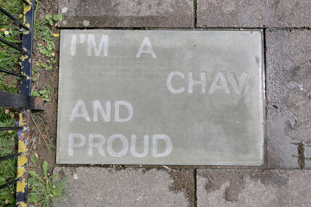 I'm a chav and proud (2017), text in water-repellent spray (words by Jenny), temporarily sited on Pelican Estate.