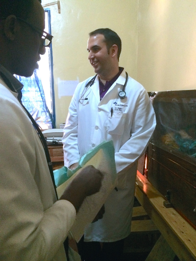 Logan teaching medical students in the NICU at Kibuye.