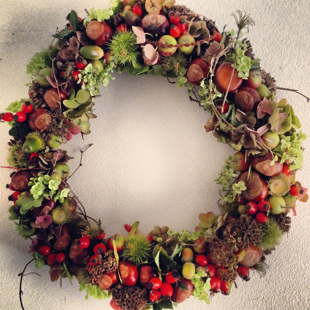 An Autumn wreath from last year. All materials were fixed to the grape vine wreath using a glue gun.