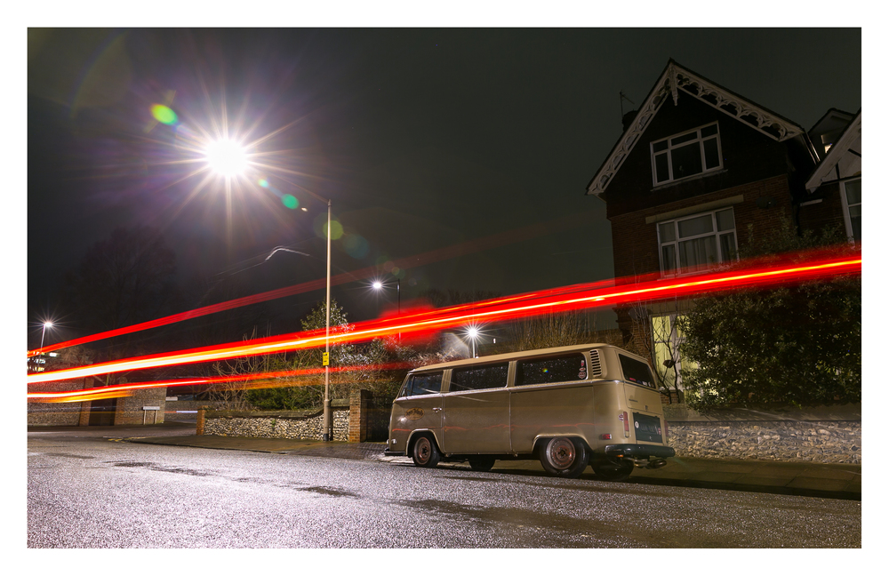 Latest photography posted on my Flickr Photo Stream  Night-time view of a restored customised VW Kombi (Combi) that is local to Eastbourne. It can be tricky shooting cars at night, especially when the best angle is on the other-side of a busy rat run cut through, and you have to allow for 30 odd second exposures,  and often have the risk of a light trail running through the shot.  On this occasion the combination of low angle for the composition and the happy occurrence of a passing car across the shot led to this pleasing combination of effect, composition and subject matter.