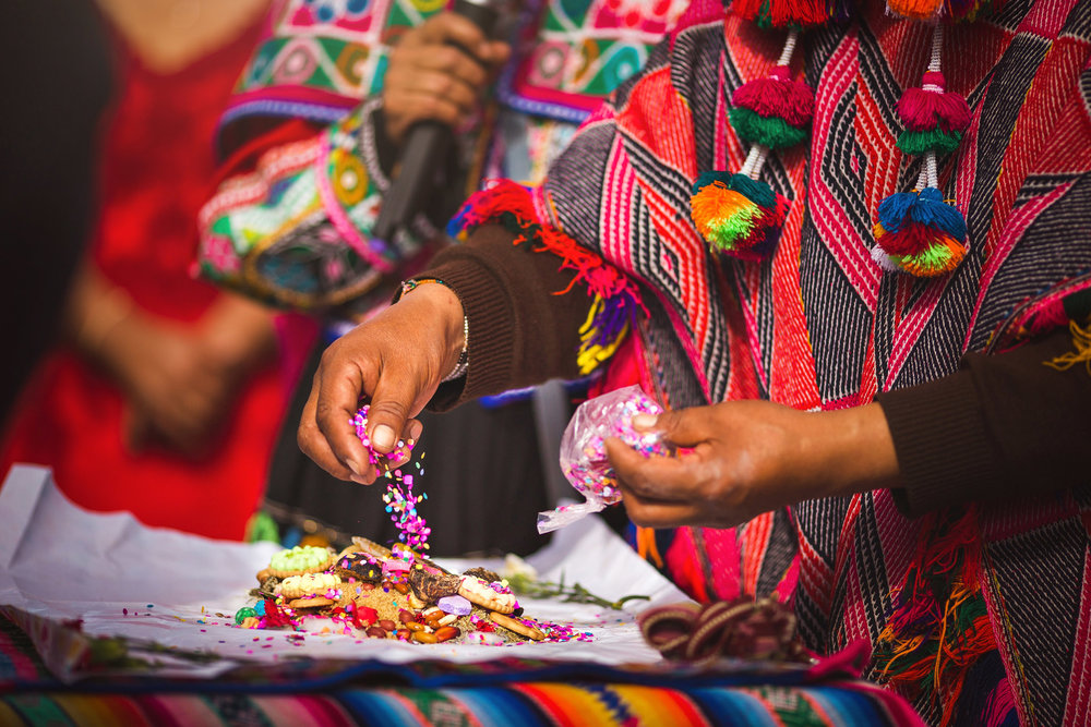 Wedding-Travellers-Destination-Wedding-Peru-Cusco-Hacienda-Sarapampa-Sacred-Valley-traditional-andean-ceremony-preparing-despacho-offer-pachamama-mother-earth-detail-colorful-shaman