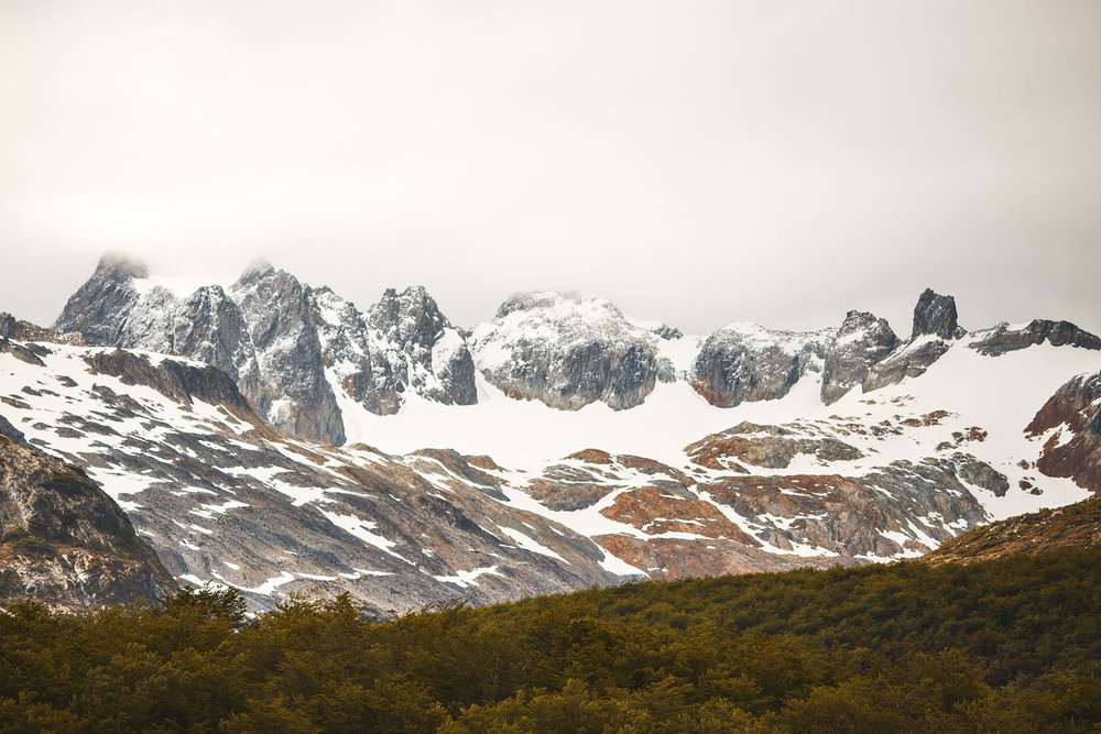 Wedding_Travellers_Ushuaia_Overlanding_fin_del_mundo-laguna-esmeralda-mountains-snow-forest