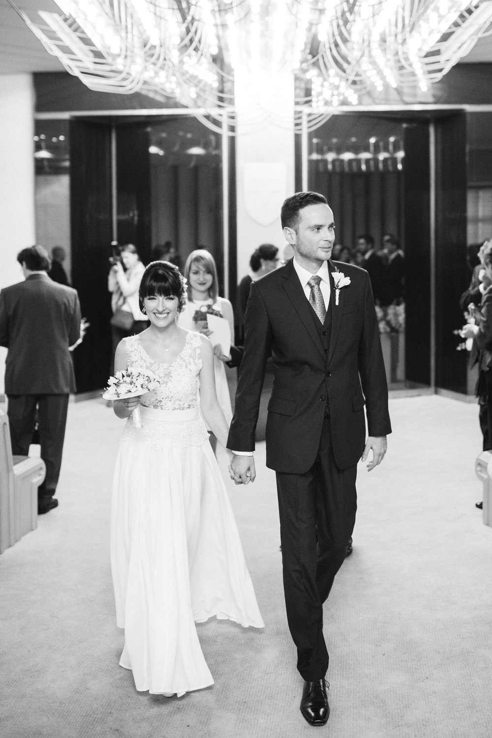 destination-wedding-photographer-bratislava-slovakia-europe-ceremony-bw-newlyweds-aisle-happy.jpg