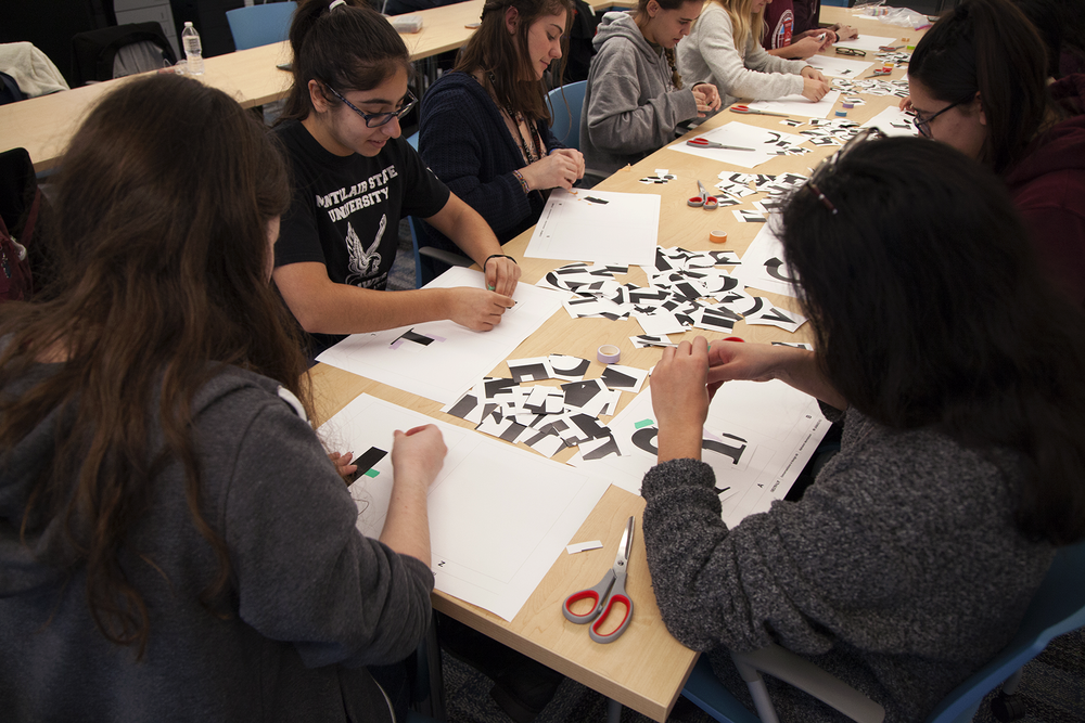 The timer starts and students begin laying down their first letterform fragments.