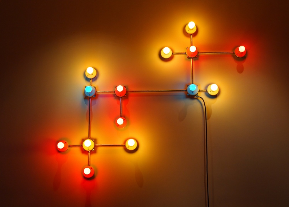 Conduits in Red, Yellow and Blue (Figure 17)  , 2013.   Galvanized steel, copper wire, porcelain fixtures and ceramic coated light bulbs.