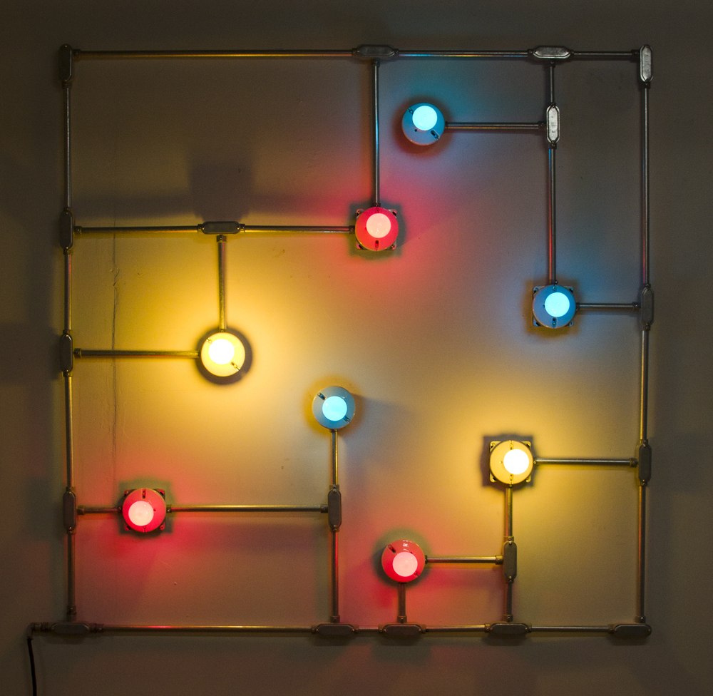 Conduits in Red, Yellow and Blue (Figure 20), 2012.   Galvanized steel, copper wire, porcelain fixtures and ceramic coated light bulbs.