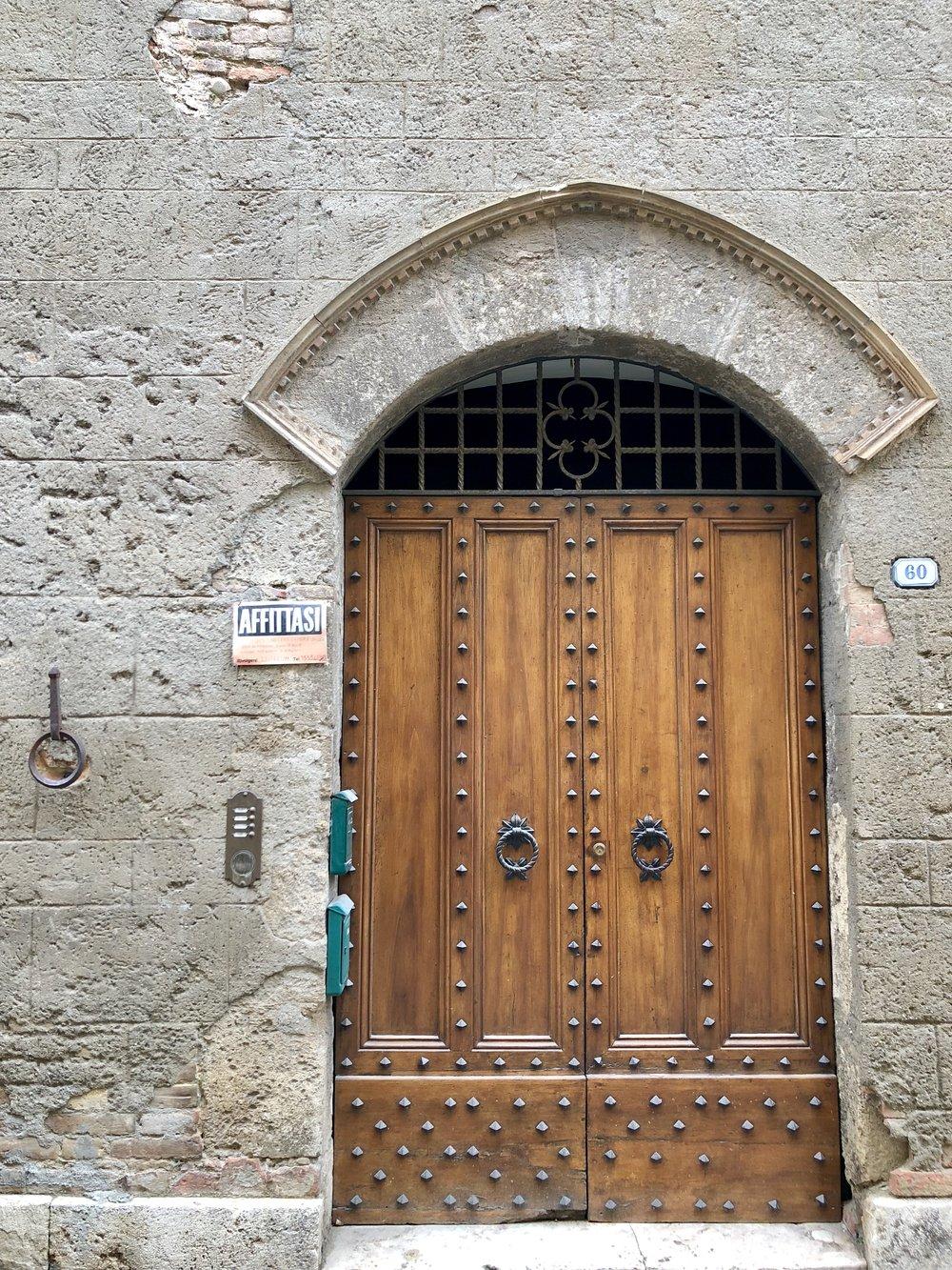 Main street in Chiusi: so many cool doors!