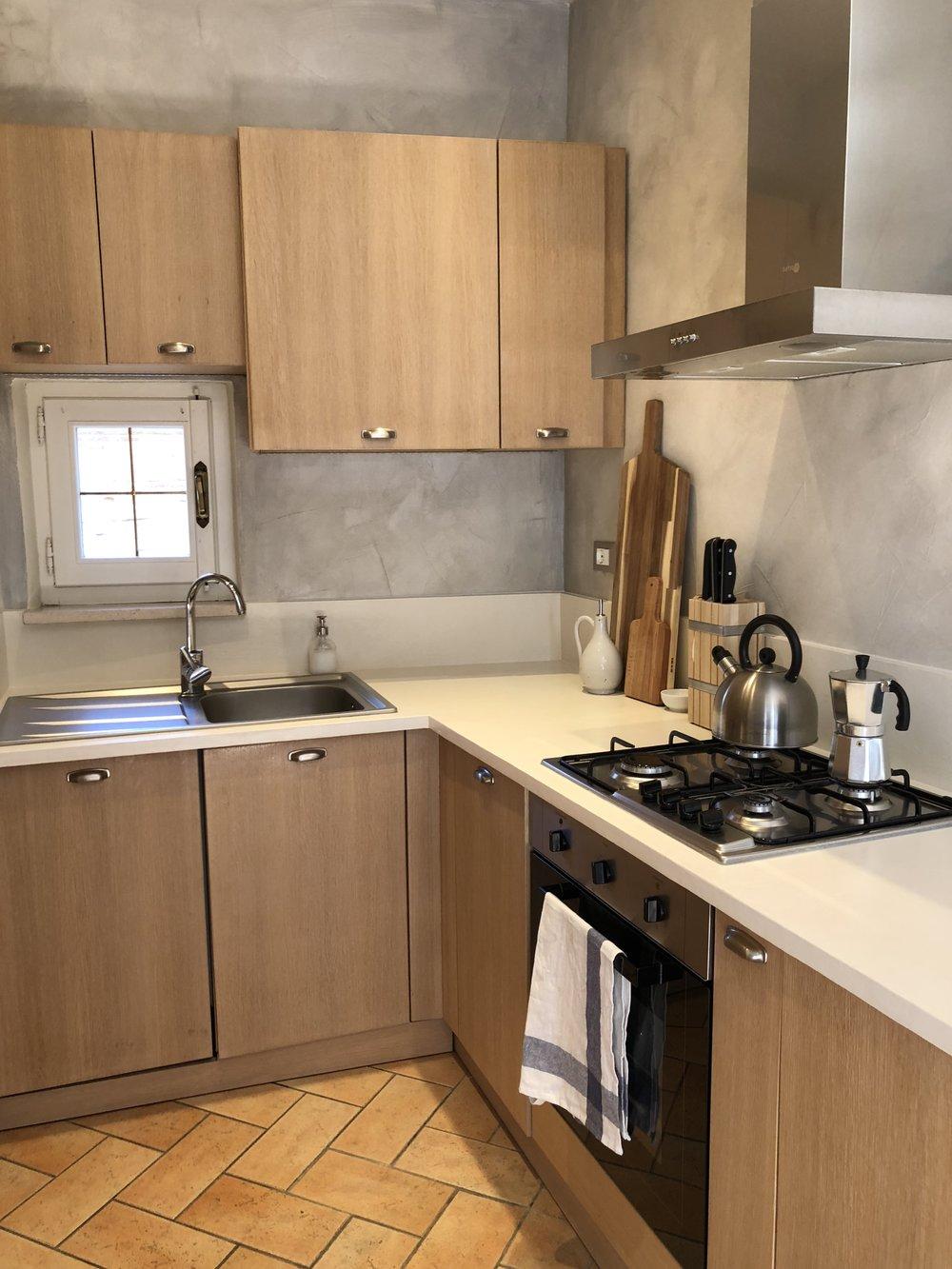Kitchen: dishwasher, oven, stove