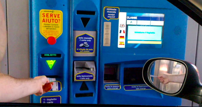 "How to use the toll booth machine:     When you enter the toll booth  (getting onto the highway), simply take a ticket.    When you exit the toll booth  (getting off the highway) enter your ticket below the green arrow (as seen in the photo above). The amount you owe will be shown on the screen.  Enter coins where it says ""coins only"" and enter bills where it says ""bills only."" Change will be dispensed below the screen."