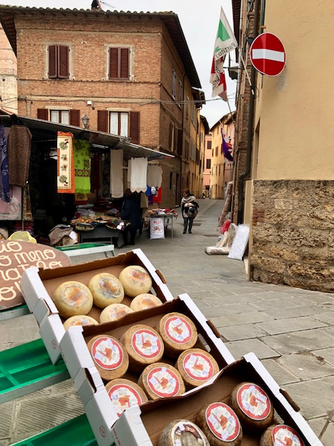 Weekly farmers market in the main square of Chiusi.  Our front door is along the street in the background of this photo.  This area of Tuscany is known for its Pecorino cheese - so good!  Try it thinly sliced with fig jam, as the Italians do.