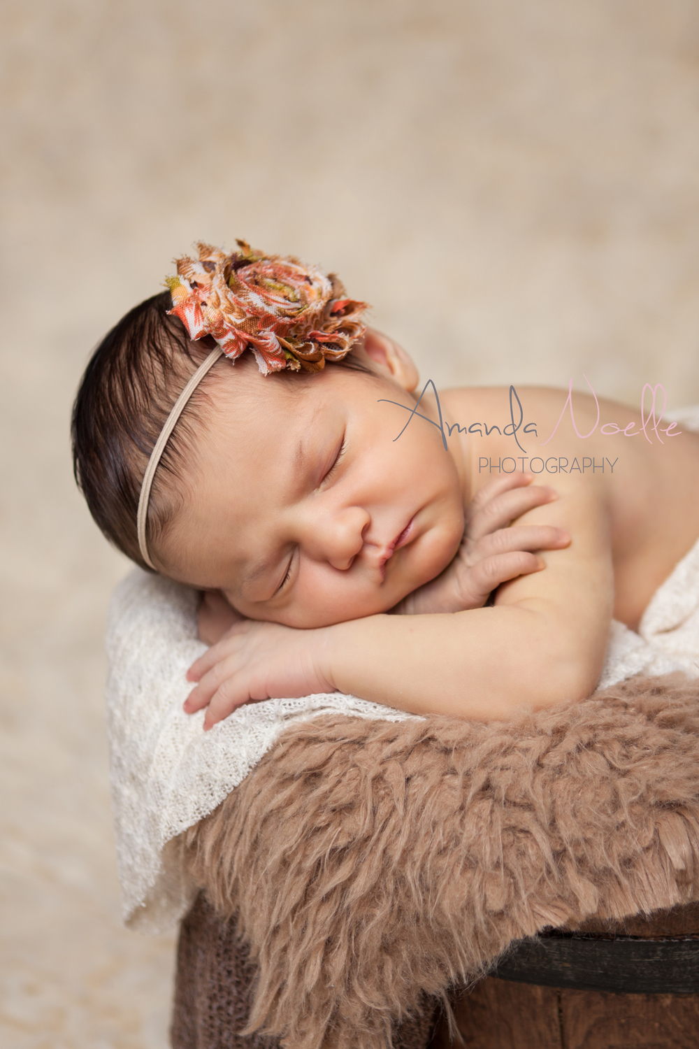 Newborn baby girl, in bucket, layering fabric and fur, headband shabby chic flower, brown creme orange, sleeping prop pose by Westchester County, New York, Newborn Photographer, Amanda Noelle Photography.