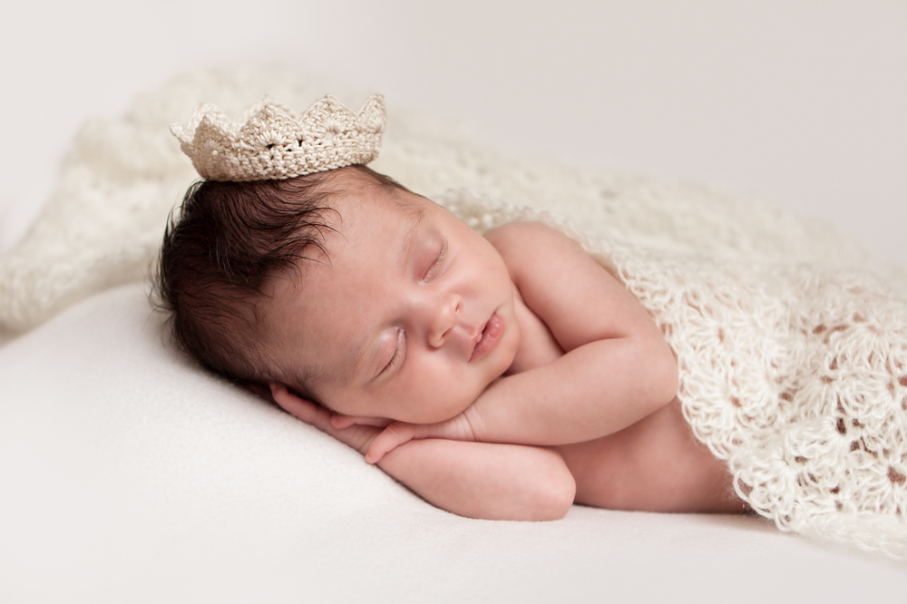 Newborn baby girl, crochet crown tiara, creme white backdrop fabric blanket, crochet wrap, sleeping baby pose on beanbag, Westchester County, New Rochelle, White Plains, Pelham, New York Newborn Photographer, Amanda Noelle Photography