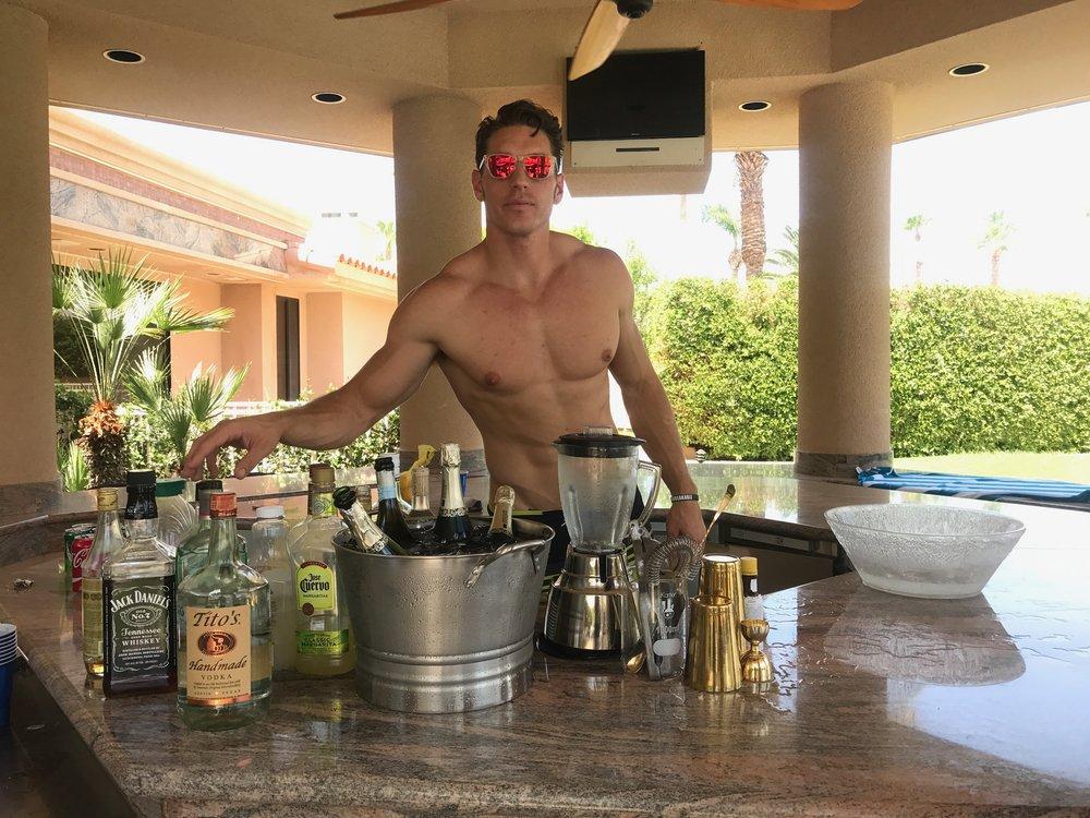 Shirtless bartender for hire.JPG