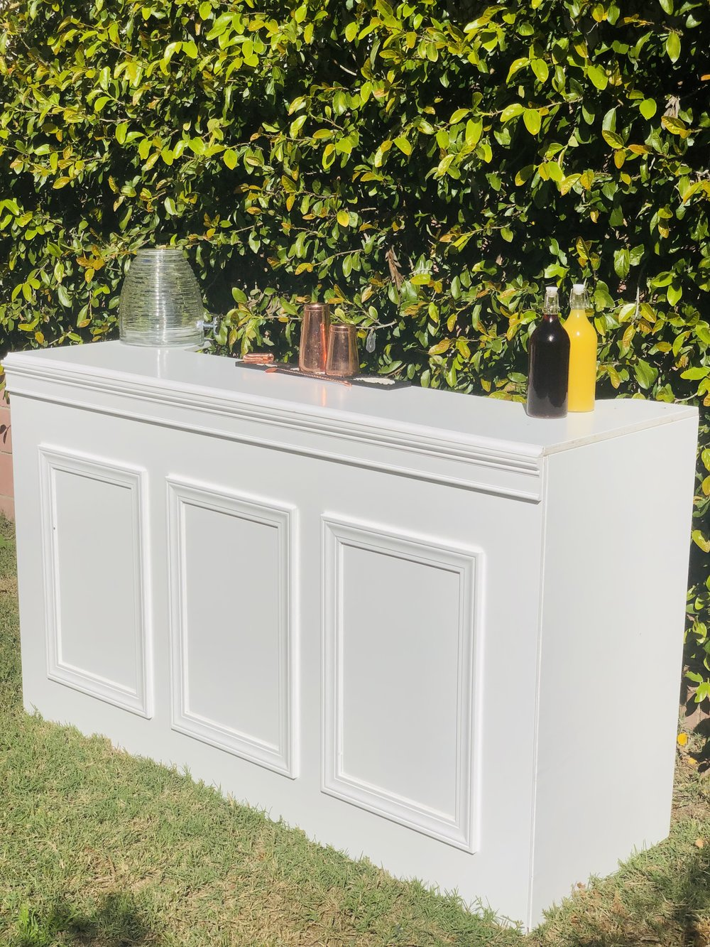 Due to demand we just add this beautiful 6'ft white paneled wooden bar! Rent yours now!