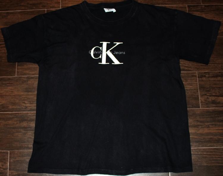 91f2a963f65d Vintage Calvin Klein Jeans Black Basic Logo T shirt (Size L/XL) — Roots
