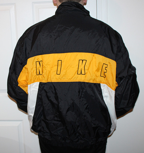 99ab4ad3d8 Vintage Nike Spell-Out Windbreaker Black   Yellow (Size XXL) — Roots