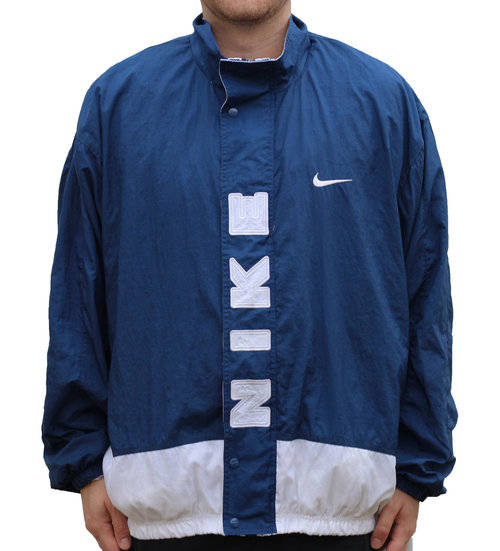 0dc0fb83f Vintage Nike Spell Out Navy Windbreaker (Size XXL) — Roots