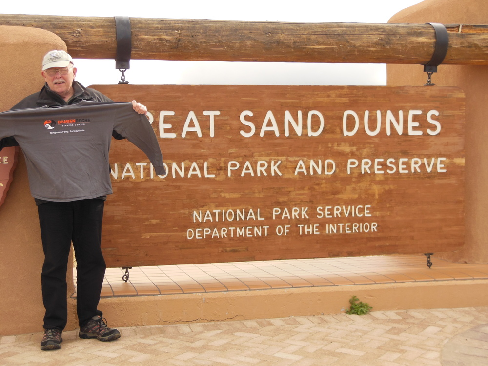 Bill at Great Sand Dunes National Park, Utah. Temps were a little cold to wear our shirt.