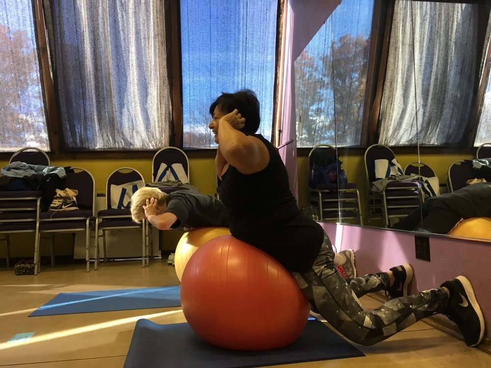 Mary and Cindy working on lower back strength.