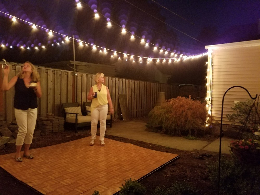 I made an attempt to rent a dance floor for the ladies but my yard is not yet level so it didn't look or feel the way it should but it definitley got me excited about the idea of a permanent dance floor in my backyard. PROJECT!