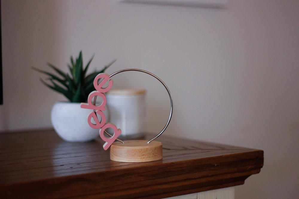 """option one - """"the bebe"""" loop - a simple 4"""" maple letter loop with the word bebe in your choice of colors. would come with an mbstyled tag attached to loop"""