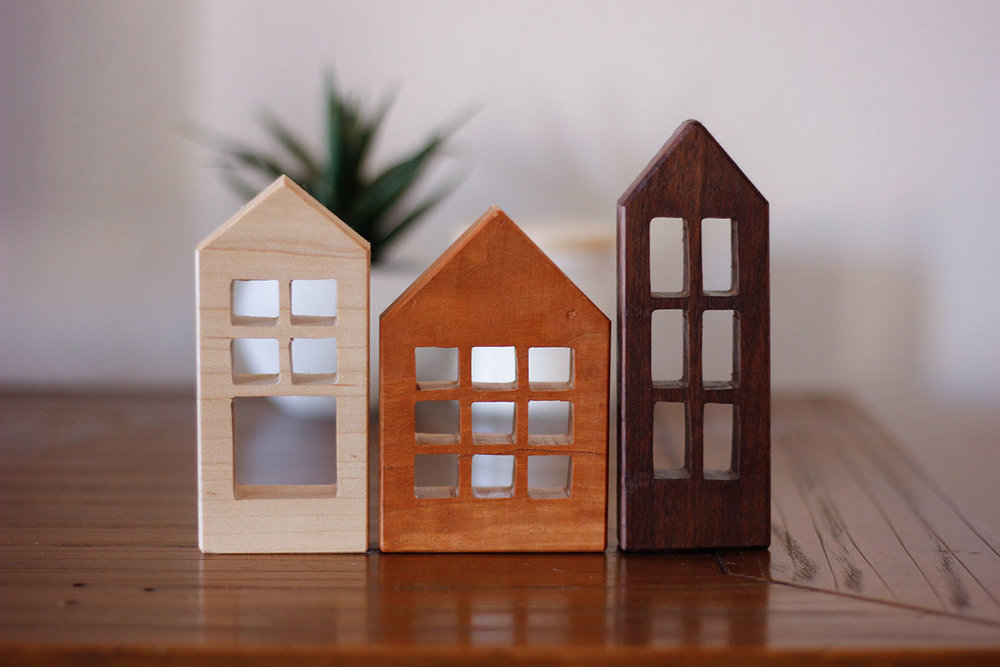 option two - mini house collection - a collection of three to four mini wooden play houses. cute decor pieces or play items for kids. the house designs we come up with would be exclusive to your boxes. would come in canvas bags stamped with the mbstyled logo