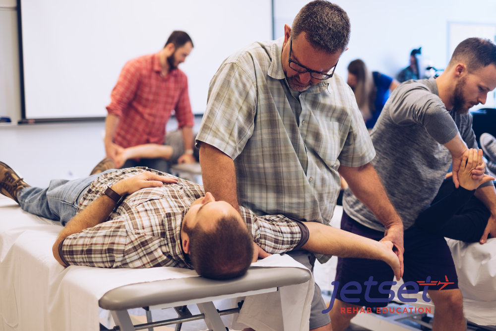 Later in the afternoon, we start the lab portion of the course.  In this photo, every detail of the neurodynamic tests were reviewed piece by piece.  In Photo -  Allen Rubin .