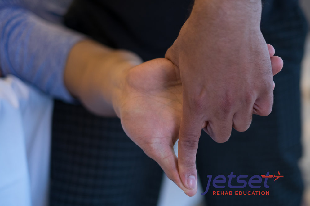 Handhold details are stressed in this course.  Median Nerve test pictured.