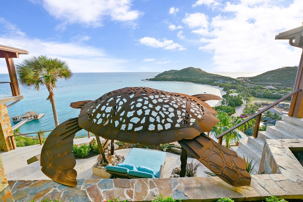 The giant sea-turtle was made of corten to further enhance its artistry as corten is a corrosion resistant steel, which displays an attractive fading effect from orange to brown creating a warm, natural look which will complements the home's colour pallet for years to come.