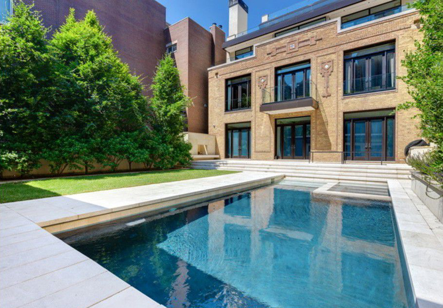 This 924 N. Clark Street luxury estate in Chicago, once priced at $15 million, is now $10,900,000.