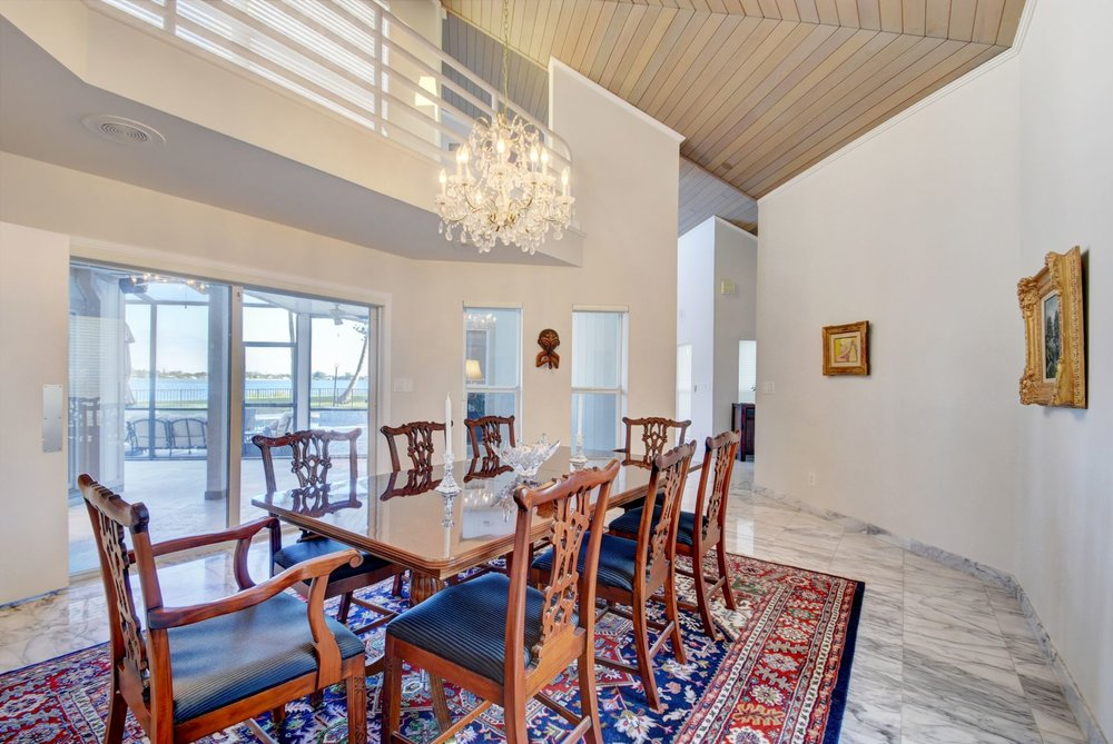 4+Woodbrook+Circle+WPB+33401+Virtuals1+DR+from+Fam+Rm+with+pool+deck+view.jpg