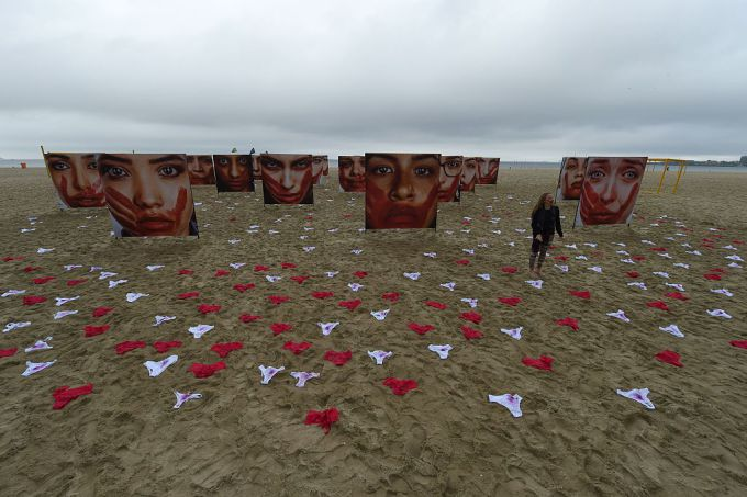 Protest on Copacabana beach, Rio de Janeiro. Source: 'These powerful images show how Brazil is fighting violence against women' - Hellogiggles.com