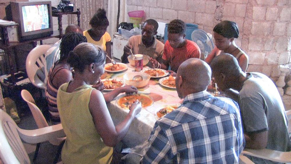 family enjoying_soup_Joumou.jpg