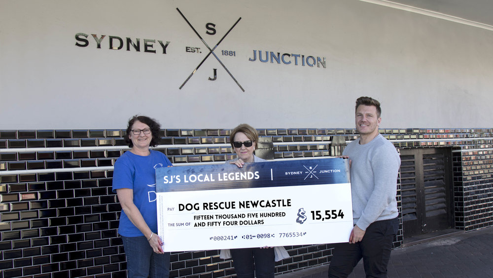Chris Stratton presenting Rhonda Domanti and Sue Barker with a cheque for $15, 554