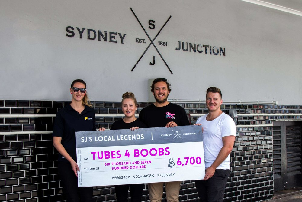 Marketing Director, Chris Stratton, presenting Courtney and Marlenn from Tubes 4 Boobs & Alyssa from the Newcastle Cancer Council with a cheque for $6, 700