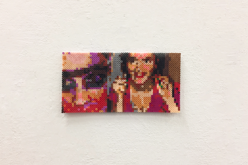 "Peeking   plastic beads.  5"" x 13"" 0.25""  2017"