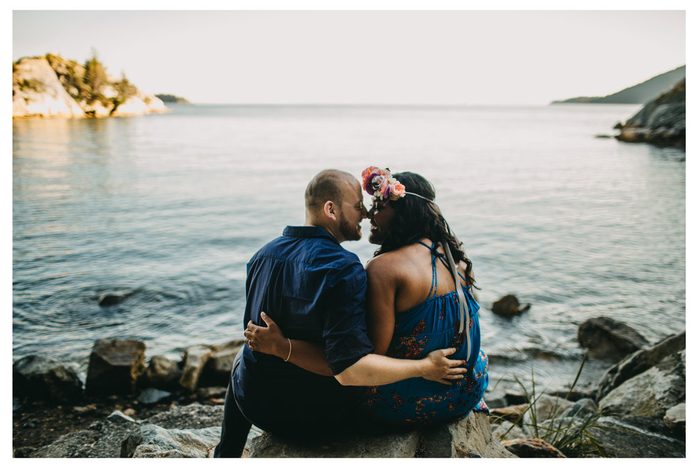 bride groom rock hug kiss engagement whytecliff park